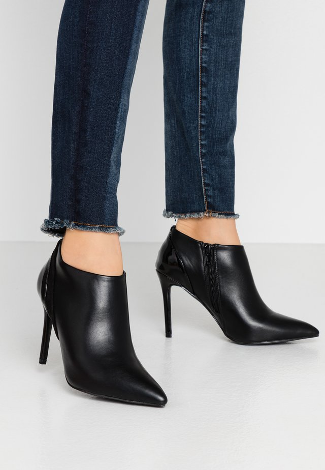 ARCHIE - Bottines à talons hauts - black