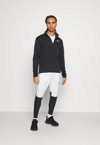 Nike Performance - SWIFT PANT - Träningsbyxor - white/black - 1