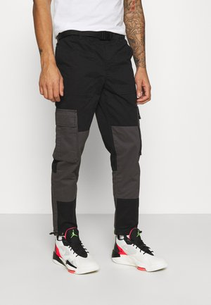 BELTED CARGO - Cargo trousers - black