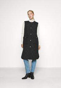 ONLY - ONLNAYRA LONG QUILT VEST - Waistcoat - black - 0