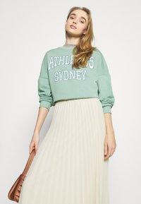 Monki - LAURA PLISSÉ SKIRT - A-line skirt - beige - 3