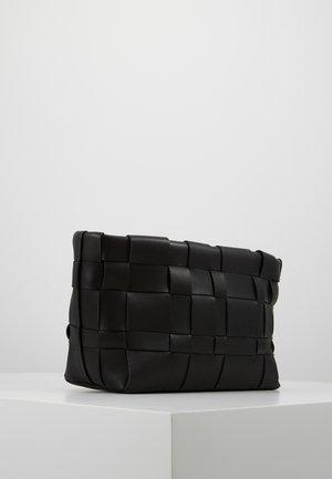 ODITA LATTICE POUCH - Handbag - black