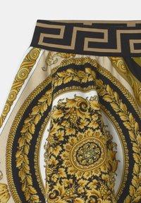 Versace - HERITAGE PRINT - Tracksuit bottoms - white/gold/kaki - 2