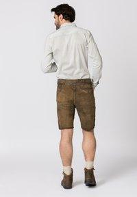 Stockerpoint - HANS - Leather trousers - havana - 2