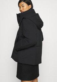 Calvin Klein Jeans - ECO PUFFER JACKET - Vinterjakke - black - 5