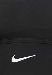 Nike Performance - LONG LINE BRA - Medium support sports bra - black/white - 2
