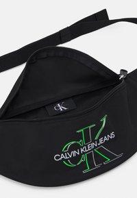 Calvin Klein Jeans - WAISTBAG GLOW UNISEX - Bæltetasker - black - 2
