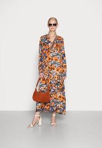 Emily van den Bergh - Day dress - black orange - 1