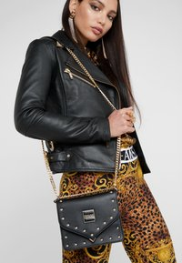 Versace Jeans Couture - STUDS SMALL SHOULDER BAG - Across body bag - nero - 1