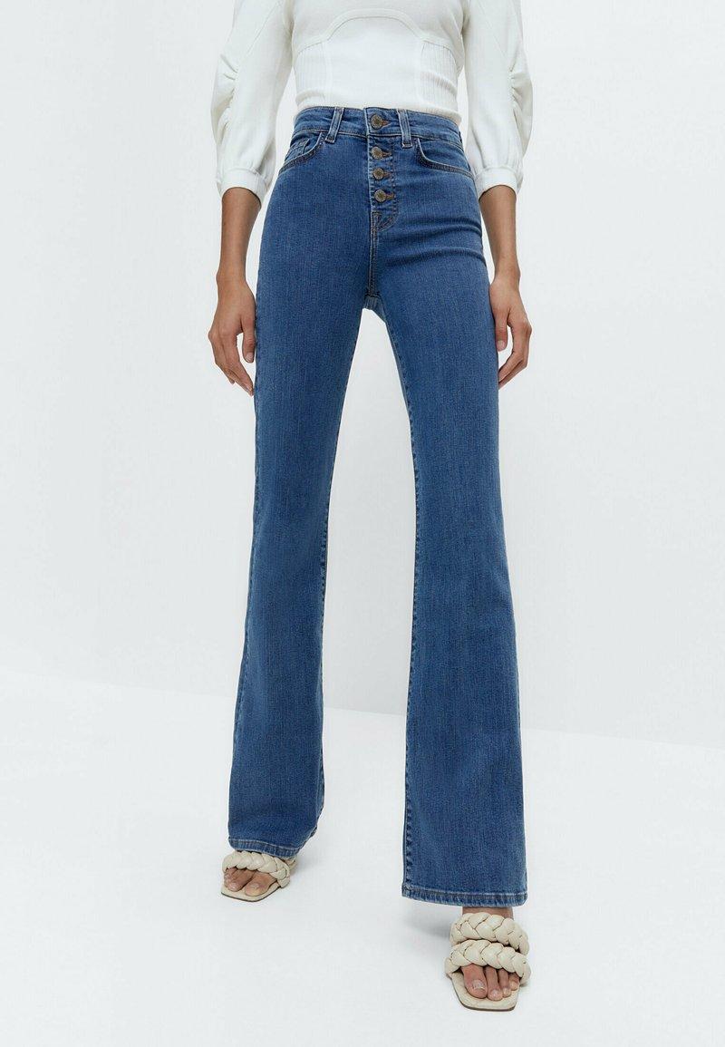 Uterqüe - Flared Jeans - blue denim