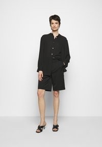 Filippa K - LAYLA BLOUSE - Button-down blouse - black - 1