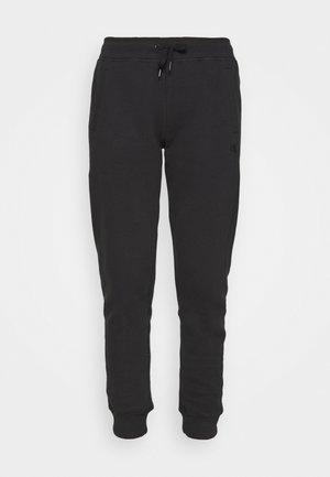 GLITTER MONOGRAM  - Teplákové kalhoty - black