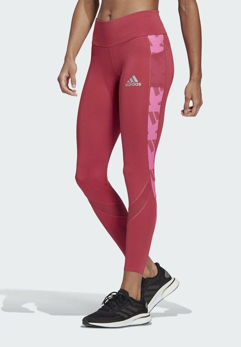 adidas Performance - OWN THE RUN CELEBRATION RUNNING LANGE TIGHT. - Leggings - pink