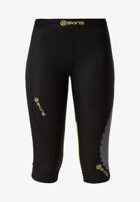 Skins - DNAMIC - 3/4 sports trousers - black/limoncello - 6