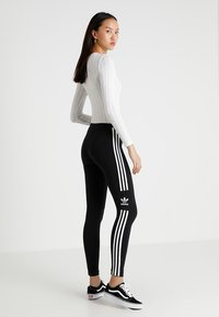 adidas Originals - ADICOLOR TREFOIL TIGHT - Leggings - black
