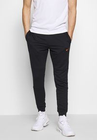Nike Performance - DRY PANT - Tracksuit bottoms - black/hyper crimson - 0