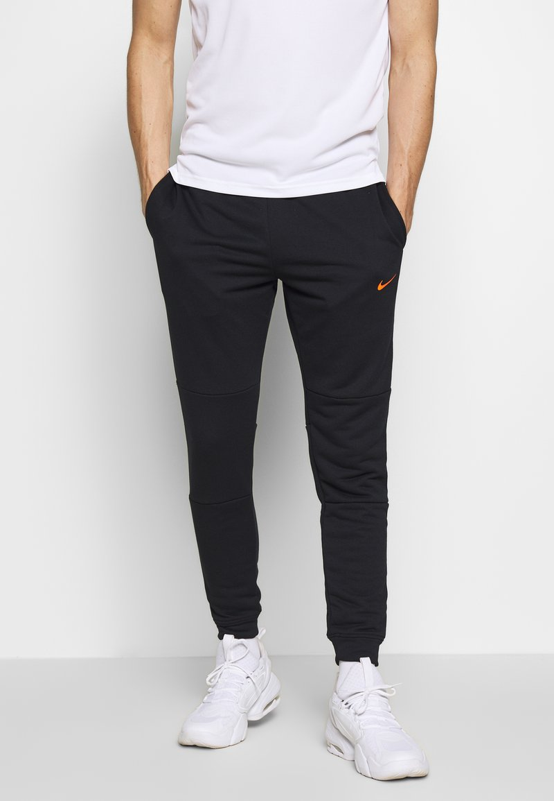 Nike Performance - DRY PANT - Tracksuit bottoms - black/hyper crimson