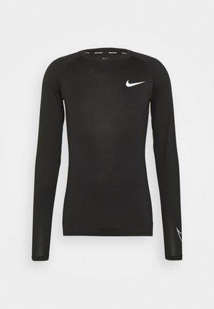 TIGHT - Camiseta de deporte - black/white