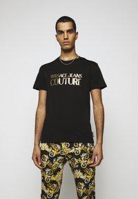 Versace Jeans Couture - MOUSE - T-shirt imprimé - black - 0