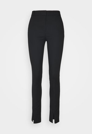 VMCLANSY TAPERED SLIT PANTS - Trousers - black