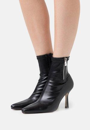 RUBINA - Classic ankle boots - black
