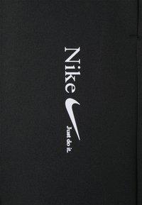 Nike Sportswear - TREND PANT - Tracksuit bottoms - black - 6
