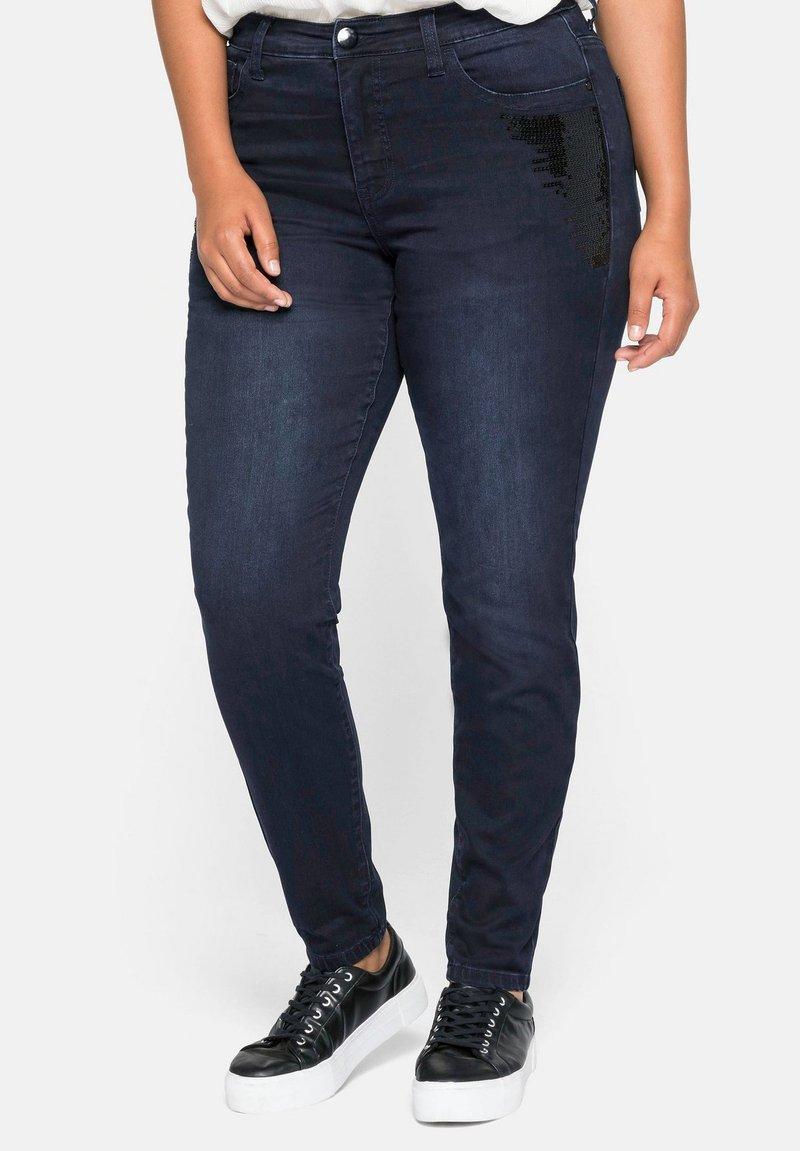 Sheego - Slim fit jeans - blue black denim