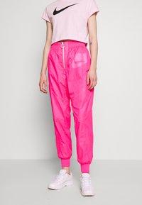Nike Sportswear - Tracksuit bottoms - hyper pink/pinksicle/white - 0