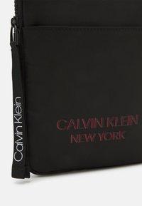 Calvin Klein - FLAT PACK UNISEX - Across body bag - black - 3