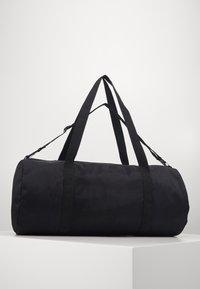 Nike Sportswear - HERITAGE DUFFLE  - Sports bag - black/black/white - 1