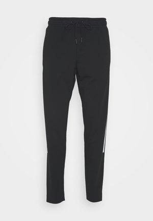 SPORT STYLE OPTIKS PANT - Tracksuit bottoms - black