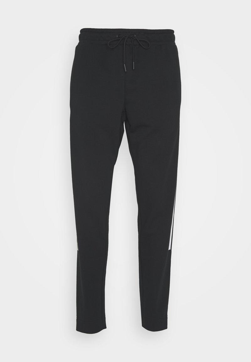 New Balance - SPORT STYLE OPTIKS PANT - Tracksuit bottoms - black