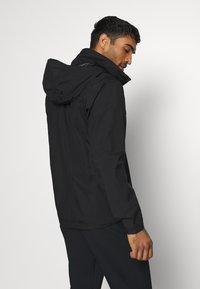 adidas Performance - FOUNDATION RAIN.RDY HIKING JACKET - Hardshell jacket - black - 2