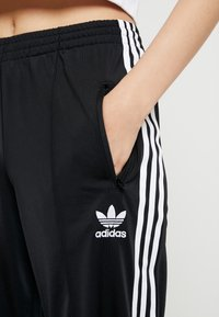 adidas Originals - FIREBIRD ADICOLOR TRACK PANTS - Träningsbyxor - black - 5
