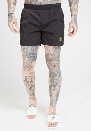 CRUSHED TAPE - Shorts - black/gold