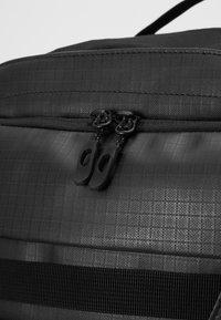 Dakine - RANGER TRAVEL PACK 45L UNISEX - Backpack - black - 7