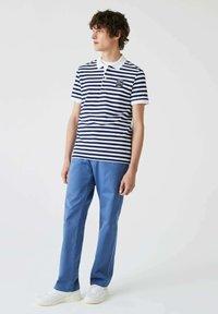Lacoste - Polo shirt - bleu  blanc - 0