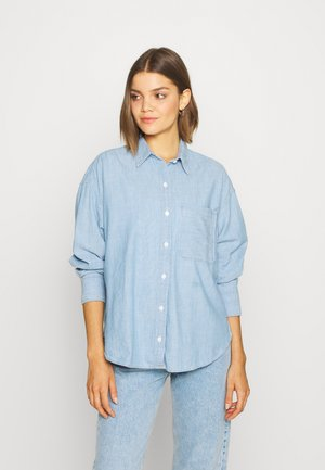 THE RELAXED - Button-down blouse - light blue denim