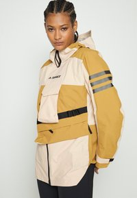 adidas Performance - TERREX XPLORIC RAIN - Hardshell jacket - halo blush/mesa - 6