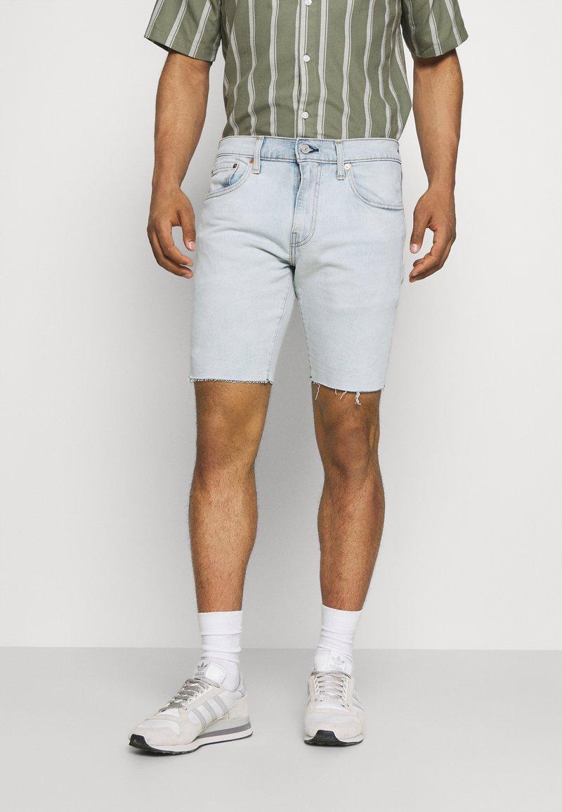 Levi's® - 412™ SLIM - Denim shorts - light blue denim