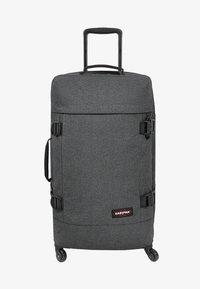 Eastpak - TRANS4 M CORE COLORS  - Wheeled suitcase - black denim - 1