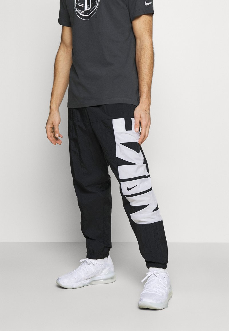 Nike Performance - STARTING PANT - Tracksuit bottoms - black/white