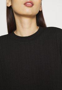 Monki - Camiseta estampada - black - 4