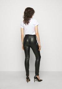 HUGO - HONATI - Leggings - Trousers - black - 2