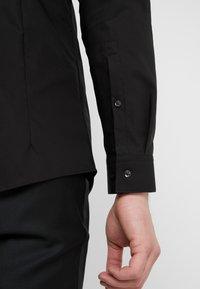 HUGO - ERRIKO EXTRA SLIM FIT - Formal shirt - black - 5