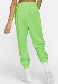 Nike Sportswear - Tracksuit bottoms - green strike/vapour green/white - 1