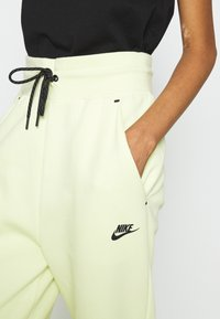 Nike Sportswear - Tracksuit bottoms - life lime/black - 5