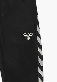Hummel - KICK - Tracksuit bottoms - black - 3