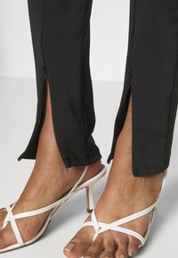 Gina Tricot - JADA SLIT - Leggings - Trousers - black - 3