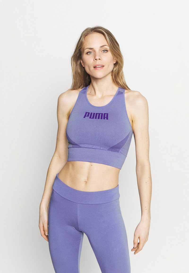 Puma - EVOSTRIPE BRA - Light support sports bra - hazy blue